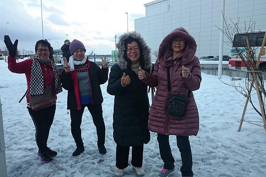 (From left) Madam Loh, Madam Teo, Madam Tham and Madam Peh experienced snow for the first time yesterday after arriving in Hokkaido. They will be there until Thursday, courtesy of Scoot which sponsored their air tickets, and Klook which sponsored the