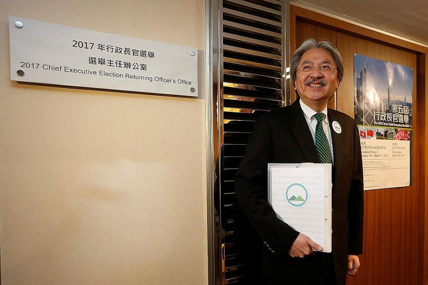 Former Hong Kong financial secretary Mr Tsang was the first to submit his nomination forms yesterday as a candidate for Hong Kong's chief executive post. Mrs Lam, Beijing's preferred candidate, is expected to submit her forms on Tuesday.