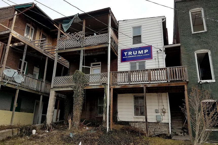 """One of the two methadone treatment centres for heroin addicts in Cumberland, Maryland (left) and a Trump sign displayed in the area (above). President Trump has promised to expand """"drug courts"""" where addicts are closely supervised, and to equip first"""