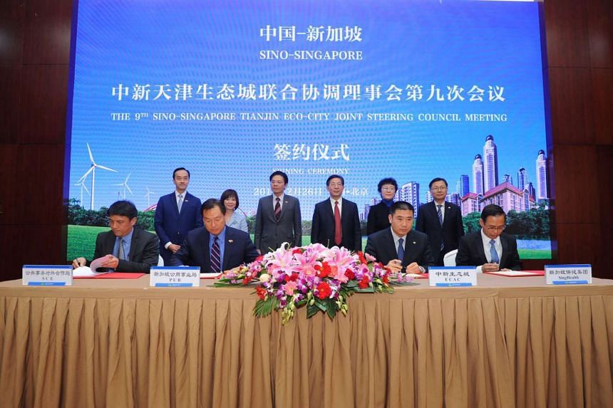 Minister for National Development Lawrence Wong and Tianjin Mayor Wang Dongfeng witnessed the signing ceremony of four memorandums of understanding and a strategic framework agreement at a hotel in Beijing on Sunday (Feb 26).