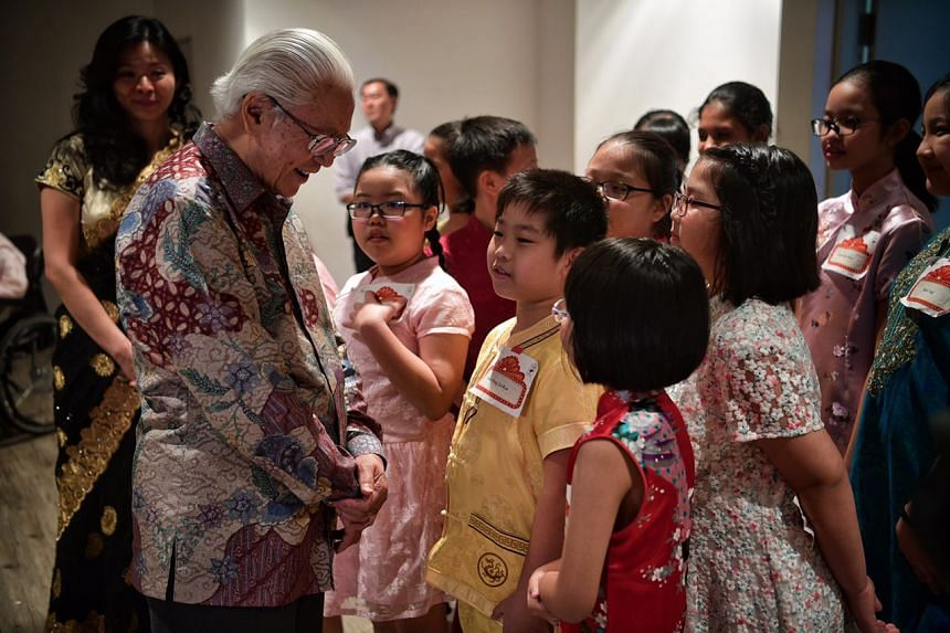 President Tony Tan Keng Yam speaking to children from the Baby Grand Choir after the launch of the President's Challenge 2017 at Sota on Feb 26, 2017.