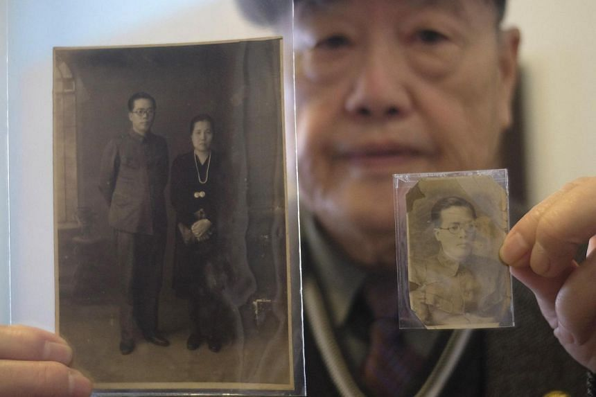 Pan Hsin-hsing, the son of a '228 Victim' which is used to refer to those executed in the Feb 28, 1947 incident, displays pictures of his parents during an interview in Taipei.