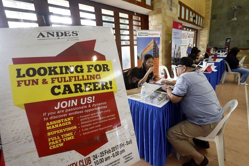 A job seeker is being interviewed at the Marsiling Job Fair 2017 on Feb 24, 2017.