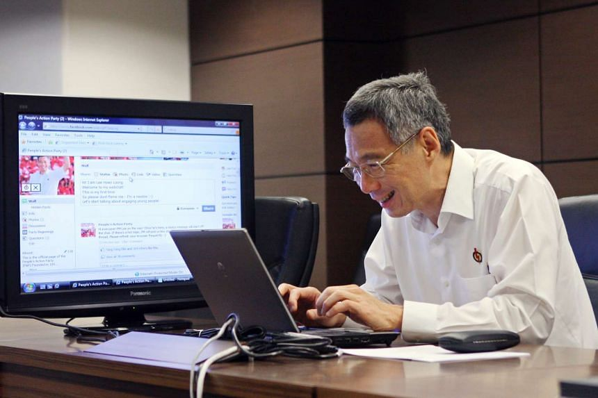Prime Minister Lee Hsien Loong chatting online with netizens on Facebook, a social networking website, at the People's Action Party headquarters on May 4,  2011.