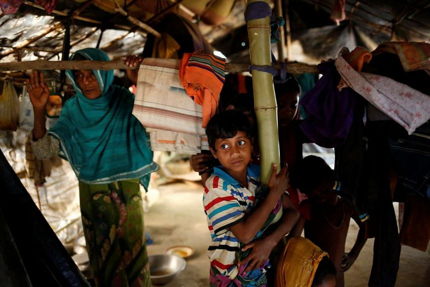 Rohingya refugees look on inside their house at Balukhali Makeshift Refugee Camp in Cox's Bazar, Bangladesh,on Feb 8, 2017.
