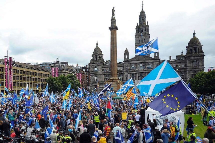 Pro-Scottish Independence supporters with Scottish Saltire flags and EU flags among others rally in George Square in Glasgow, Scotland on July 30, 2016 to call for Scottish independence from the UK.
