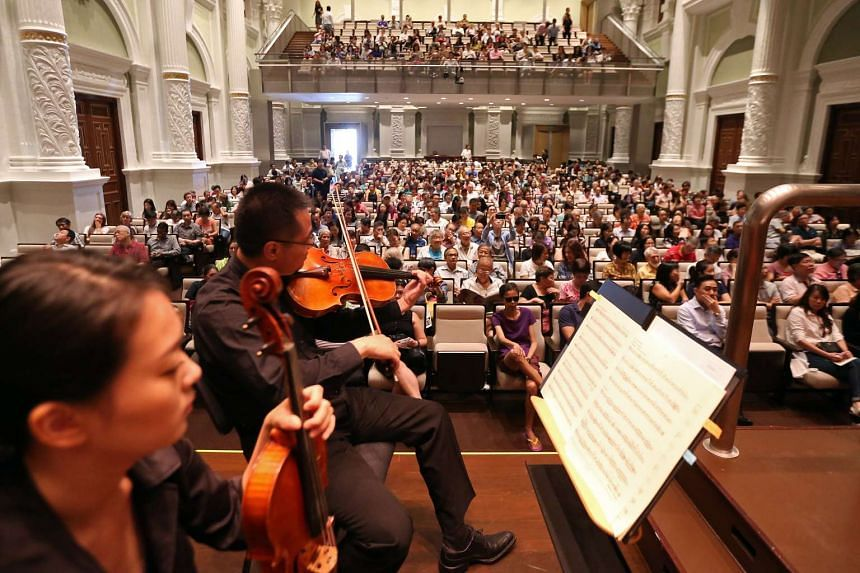 File photo of Singapore Symphony Orchestra musicians getting ready for a concert at Victoria Concert Hall.