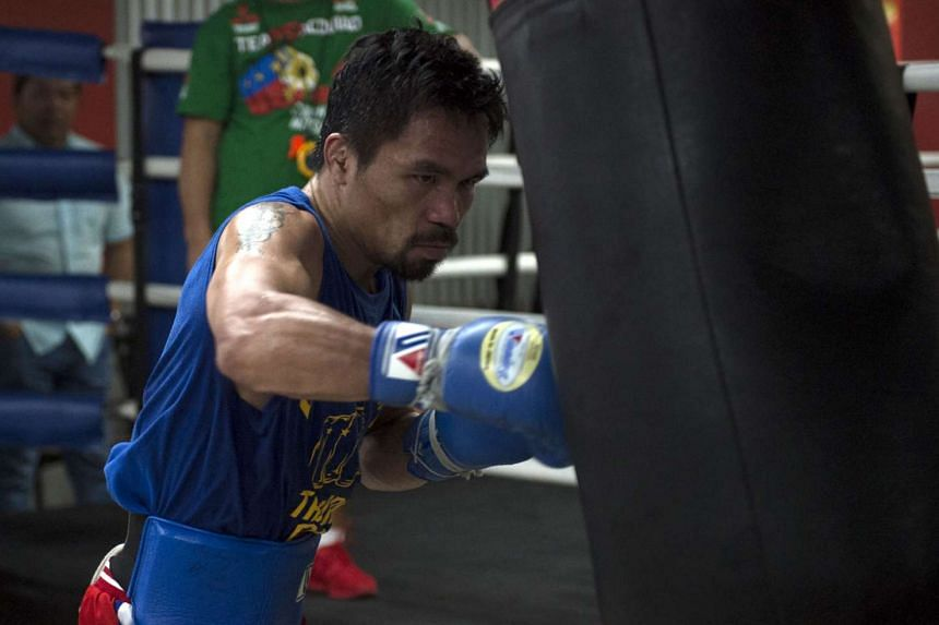 Filipino boxing hero Manny Pacquiao's office said the bout would take place in the United Arab Emirates.
