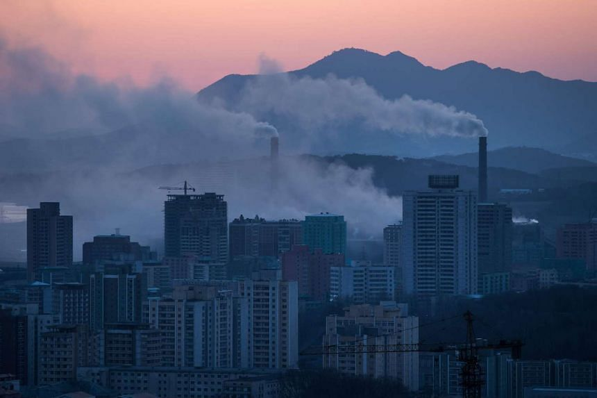 The chimneys of a power station amid the Pyongyang city skyline in a photograph taken on February 17, 2017.