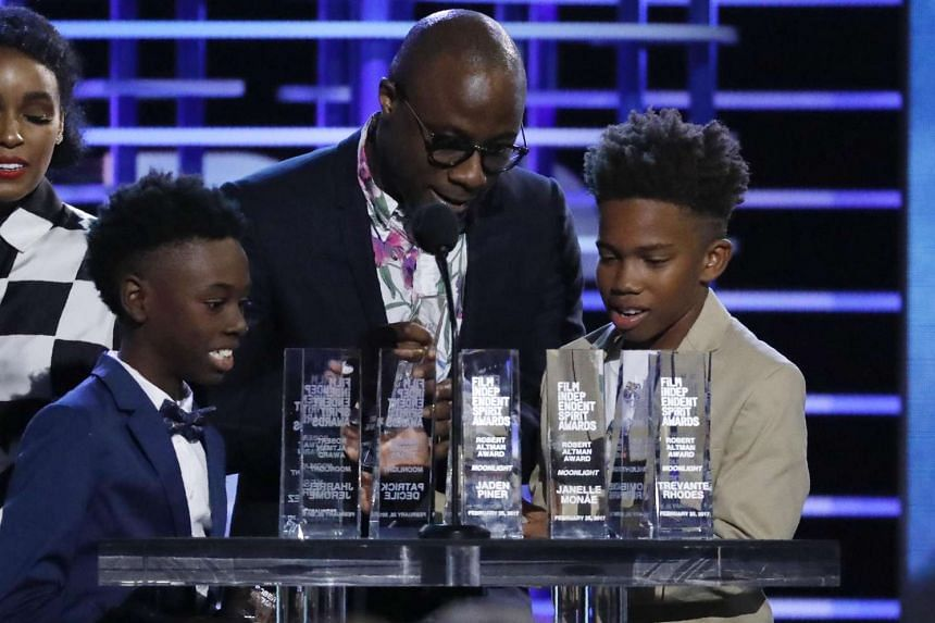 Moonlight's writer and director Barry Jenkins with the young actors from the film Alex Hibbert (left) and Jaden Piner accepting the special Robert Altman achievement awards at the 2017 Film Independent Spirit Awards in Santa Monica, California, US, o