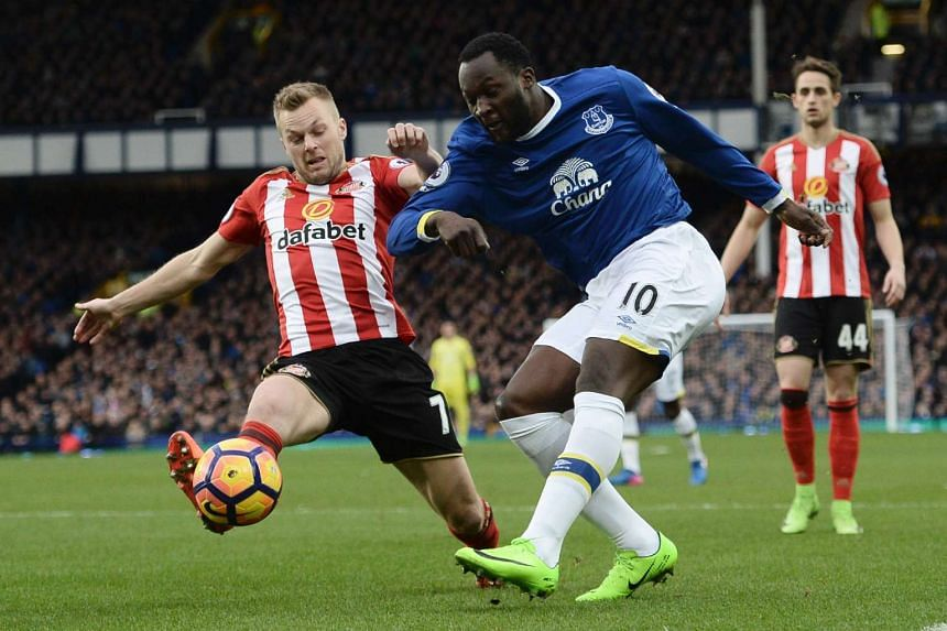 Everton's Belgian striker Romelu Lukaku (right) and Sunderland's Swedish midfielder Sebastian Larsson during an English Premier League football match at Goodison Park in Liverpool, England, on Saturday (Feb 25).