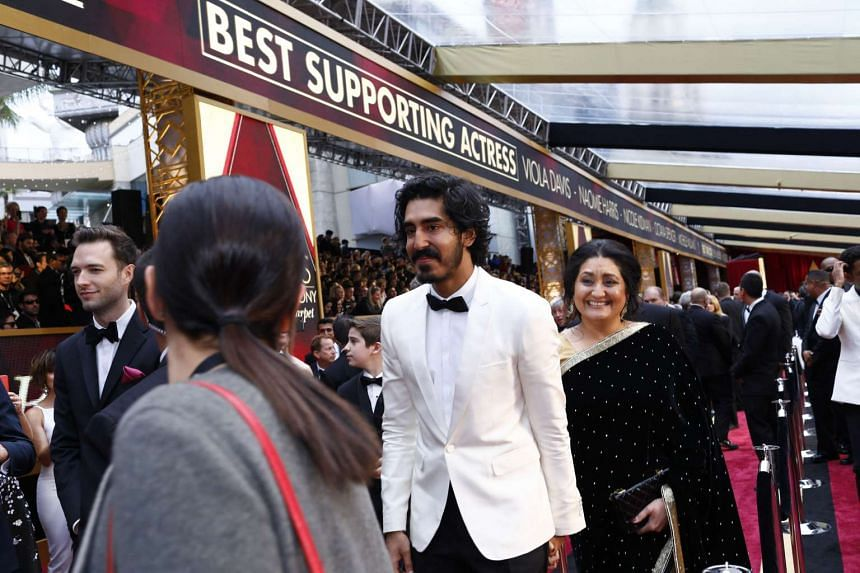 Dev Patel, nominated for best actor in a supporting role for Lion, with his mother, Anita, on the red carpet before the 89th Academy Awards at the Dolby Theatre in Los Angeles, on Feb 26, 2017.