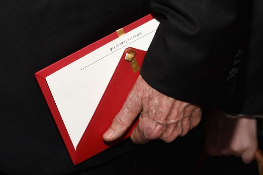 Actor/filmmaker Warren Beatty holds the envelope containing the name of the Best Picture winner.