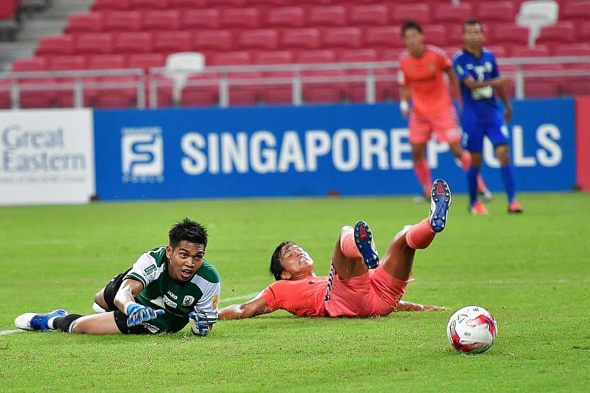 Tampines goalkeeper Izwan Mahbud watching in vain as this attempt by substitute Shoichiro Sakamoto, who had equalised at 1-1, beats him and rolls into the net for what turned out to be the winning goal for Albirex, who retained the Community Shield.