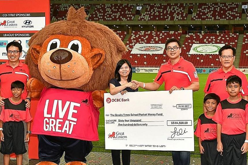 Above: Great Eastern managing director, life and regional bancassurance, Khoo Kah Siang presenting a cheque to Tan Bee Heong, general manager of The Straits Times School Pocket Money Fund, after the Community Shield match. Great Eastern, the S-League