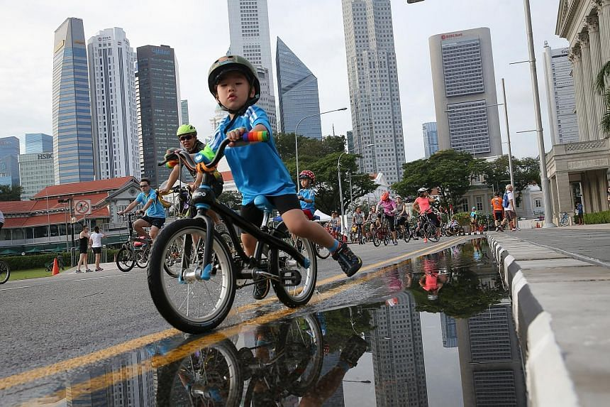A young cyclist getting a taste of riding on roads free of vehicular traffic yesterday, as part of Car-Free Sunday in the Civic District. In conjunction with the event, the Land Transport Authority gave a preview of the 90-minute Safe Riding Programm