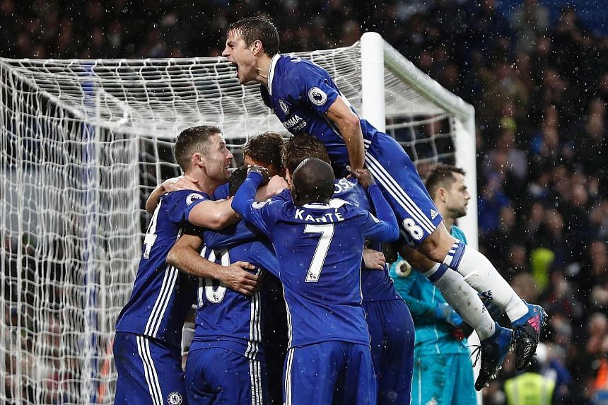Chelsea players celebrating Diego Costa's 84th minute goal, which secured a 3-1 win over Swansea. The Blues next go to West Ham in the Premier League.