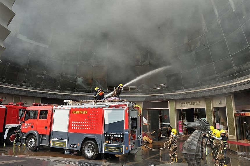 Firemen fighting a blaze at HNA Platinum Mix Hotel in Nanchang, in China's Jiangxi province, on Saturday. The authorities have detained 24 people following the fire, which was set off by unsafe welding and cutting work, state media said yesterday. Ni