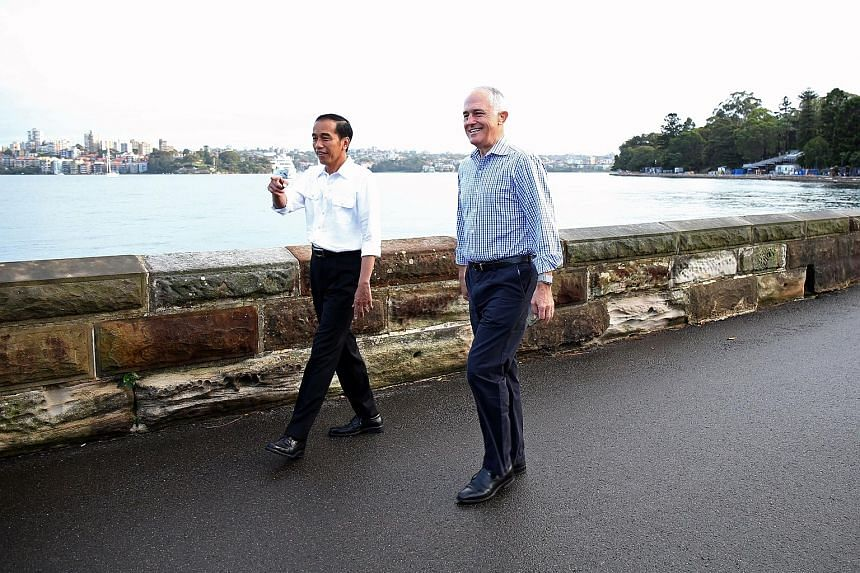 Mr Joko and Mr Turnbull sharing a lighter moment yesterday. The two leaders resolved to expand maritime cooperation, among other things.