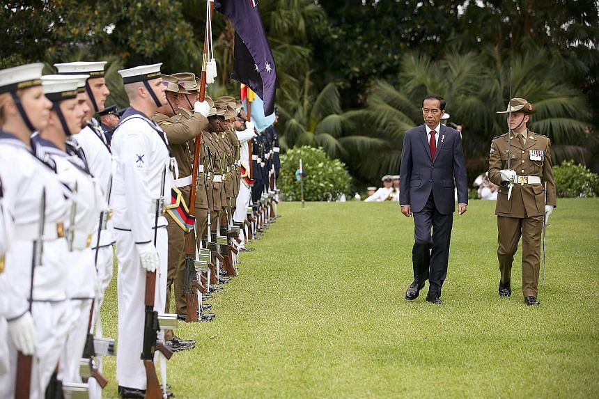 """Indonesia's President Joko inspecting a guard of honour during his welcome to Australia yesterday. He told the media that a """"robust relationship"""" between the countries is possible when both """"have respect for each other's territorial integrity, non-in"""