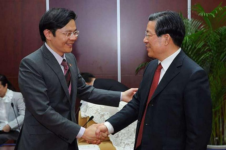 Mr Wong (far left) meeting Tianjin Mayor Wang Dongfeng yesterday in Beijing. They witnessed the signing ceremony for four MOUs and a strategic framework agreement to jointly improve Tianjin Eco-City.