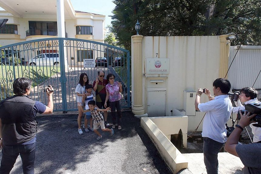 The front gate of the North Korean Embassy, located in the upscale Damansara Heights, just outside downtown Kuala Lumpur, has become a magnet for onlookers to snap pictures. They join journalists who have parked themselves there after the deadly atta