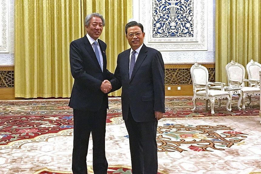 DPM Teo (left) meeting Mr Zhao Leji, head of the Organisation Department of the Chinese Communist Party (CCP), with whom he chairs the Leadership Forum, yesterday at the Great Hall of the People. Mr Teo, who is also Coordinating Minister for National