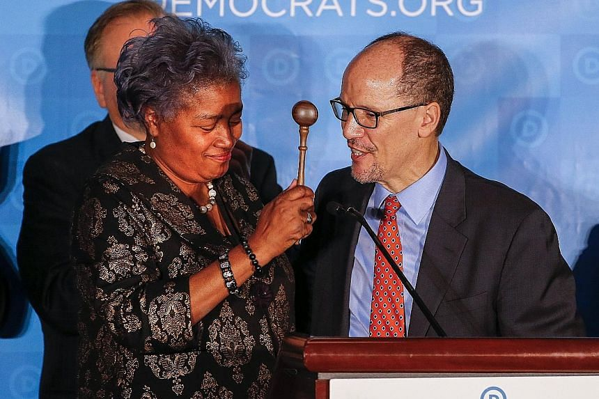 Interim chairman Donna Brazile handing the gavel to newly elected Democratic National Committee chairman Tom Perez during the DNC Winter Meeting in Atlanta, Georgia, on Saturday.
