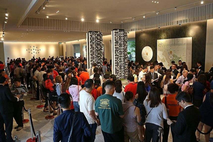 Potential buyers at the launch of the 505-unit The Clement Canopy in Clementi, which sold 195 units on the first weekend of its launch. Some buyers said they were attracted to the location and features such as the condo's lush landscaping.