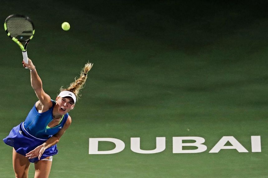 Caroline Wozniacki of Denmark returns the ball to Elina Svitolina of Ukraine during their final women's WTA Tennis Championship match in Dubai on Feb 25, 2017.