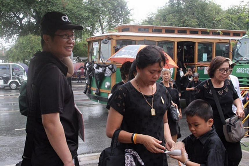 Mourners on Sunday (Feb 26) continuing to pour into Sanam Luang, north of the Grand Palace, to pay their respects to the late King Bhumibol Adulyadej ahead of a blessing ceremony for the major pillar of the royal crematorium on Monday.
