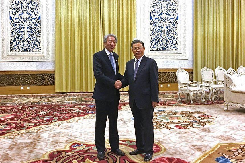 Deputy Prime Minister Teo Chee Hean (left) meeting Mr Zhao Leji, head of the Organisation Department of the Chinese Communist Party (CCP), with whom he chairs the Leadership Forum, at the Great Hall of the People, on Feb 26, 2017.