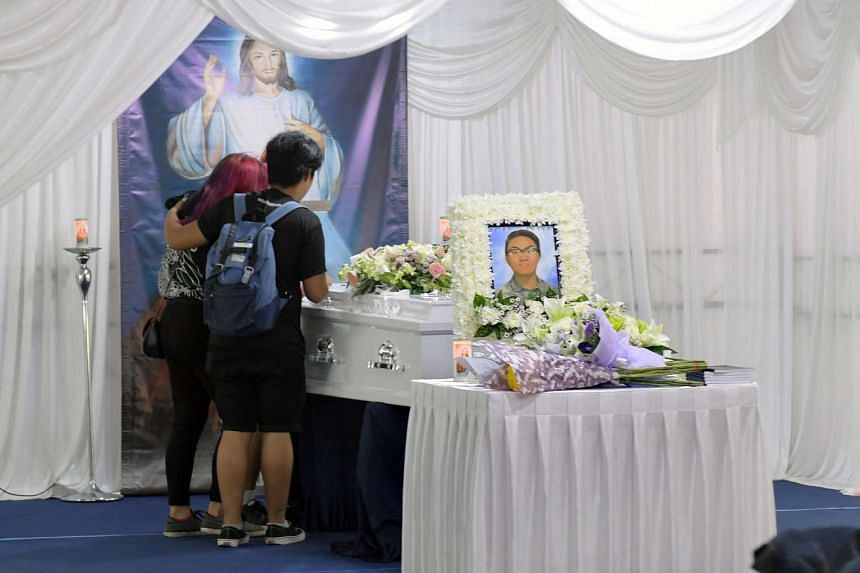 Friends attend the wake of teenager Jonathan Chow at Punggol Central on Feb 27, 2017.