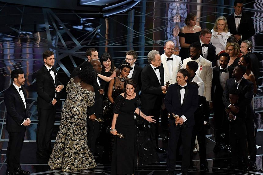 Producer Adele Romanski (centre) speaking as the cast and crew of Moonlight celebrate after it won the Best Film award at the 89th Oscars, on Feb 26, 2017, in Hollywood, California.