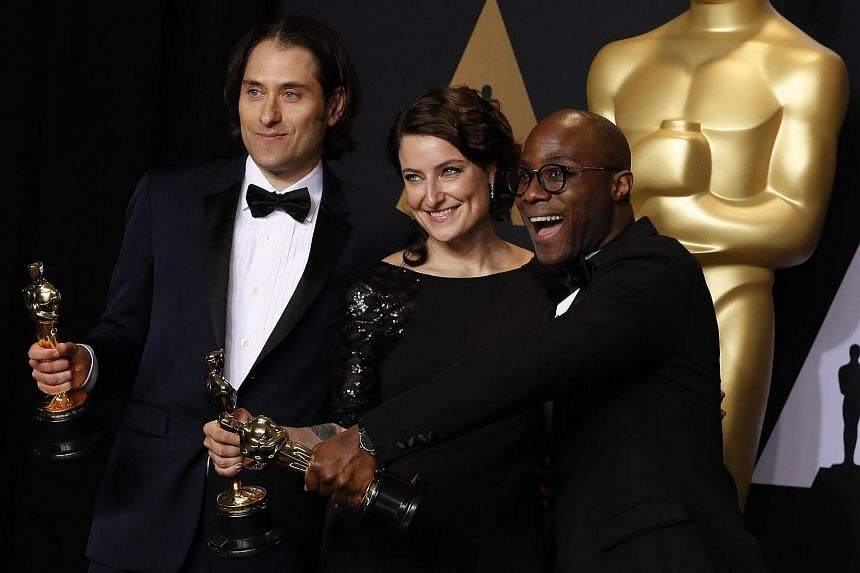 (From left) Jeremy Kleiner, Adele Romanski and Barry Jenkins posing backstage with their Best Picture Award for Moonlight.