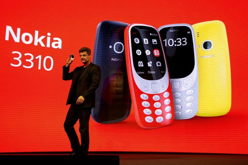 Arto Nummela, CEO of Nokia-HMD, holds up a Nokia 3310 during a presentation ceremony at the Mobile World Congress in Barcelona.