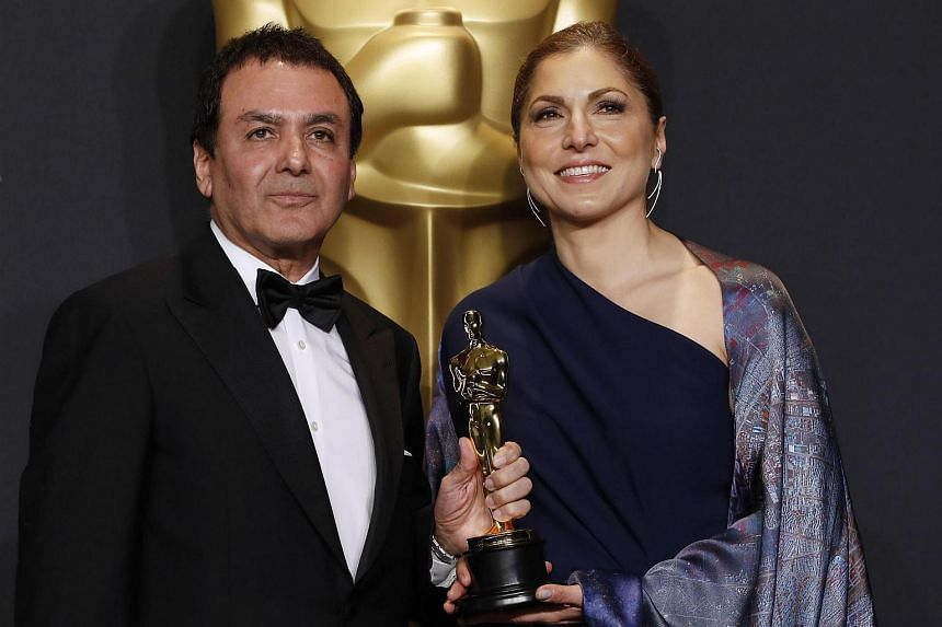 Anousheh Ansari and Firouz Naderi posing with the Oscar they accepted on behalf of Asghar Farhadi, who won the Best Foreign Language Film for The Salesman.