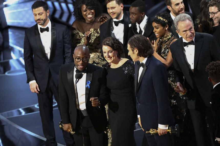 Barry Jenkins and the cast and crew of Moonlight celebrating after winning the Oscar for Best Picture during the 89th Academy Awards at Los Angeles, on Feb 26, 2017.