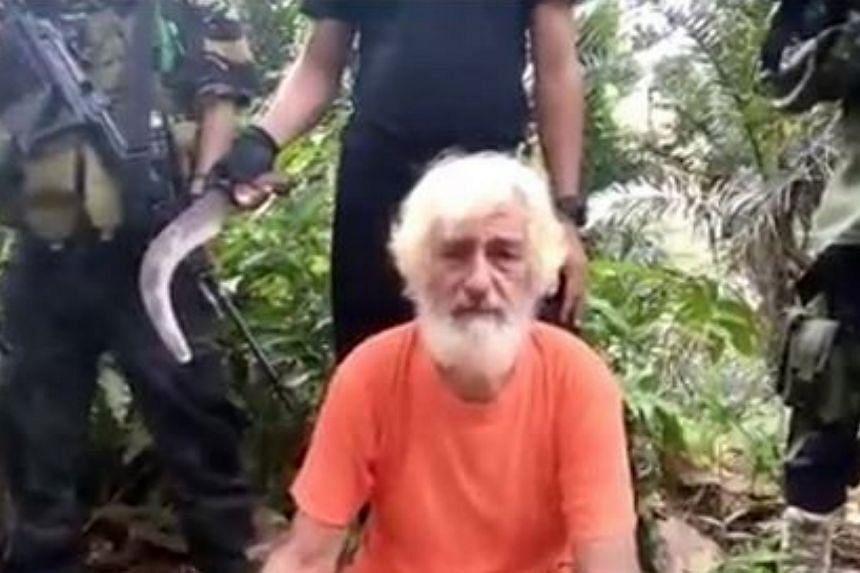 Hostage Mr Jurgen Kantner surrounded by militants before his execution.