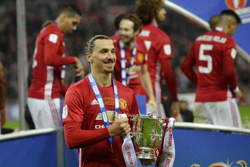 Manchester United's Zlatan Ibrahimovic celebrates with the trophy after winning the EFL Cup Final.
