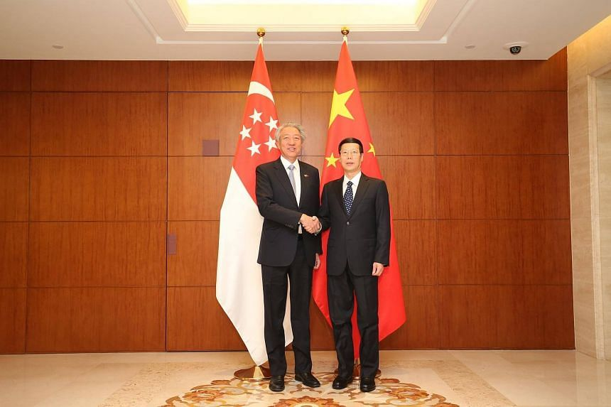 With a firm handshake, Deputy Prime Minister Teo Chee Hean and his Chinese counterpart Zhang Gaoli began their bilateral meeting.
