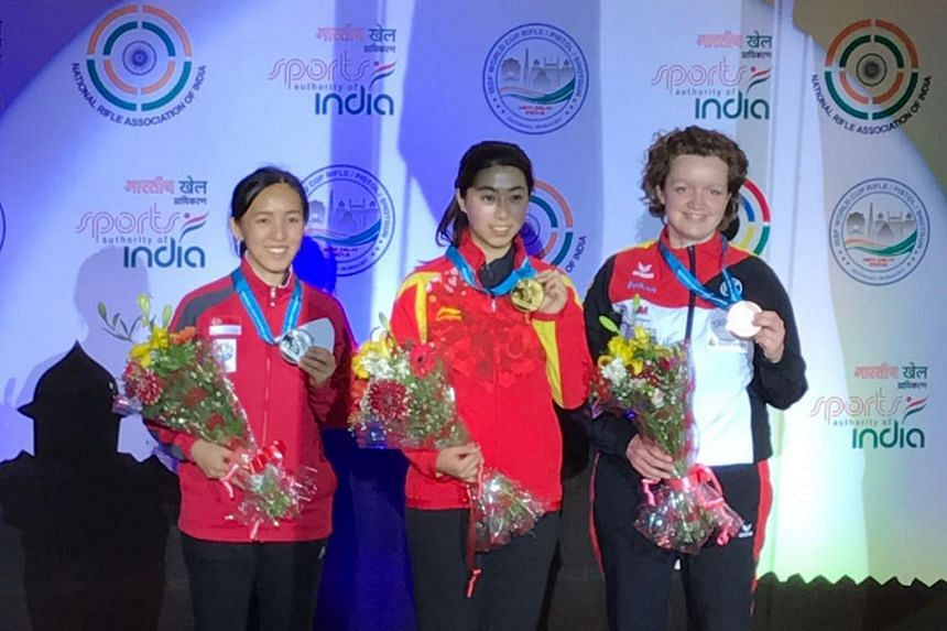 Singapore shooter Jasmine Ser (extreme left) won a silver in the women's 50m rifle three positions event at the ISSF World Cup in New Delhi, finishing behind China's Zhang Yiwen and ahead of German Eva Roesken.