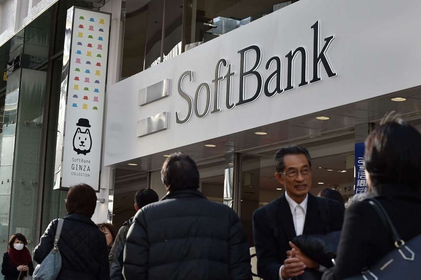 The logo of Japanese mobile provider SoftBank is displayed at an entrance of a shop in Tokyo's shopping district Ginza, on Feb 8, 2017.
