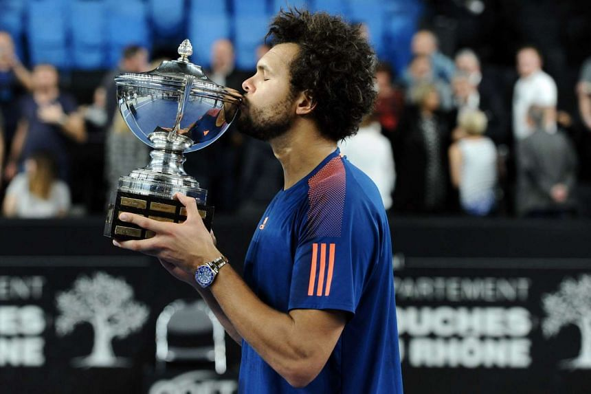 France's Jo-Wilfried Tsonga celebrates with his trophy after winning his ATP Marseille Open 13 tennis final match against France's Lucas Pouille on Feb 26, 2017 in Marseille, southern France.