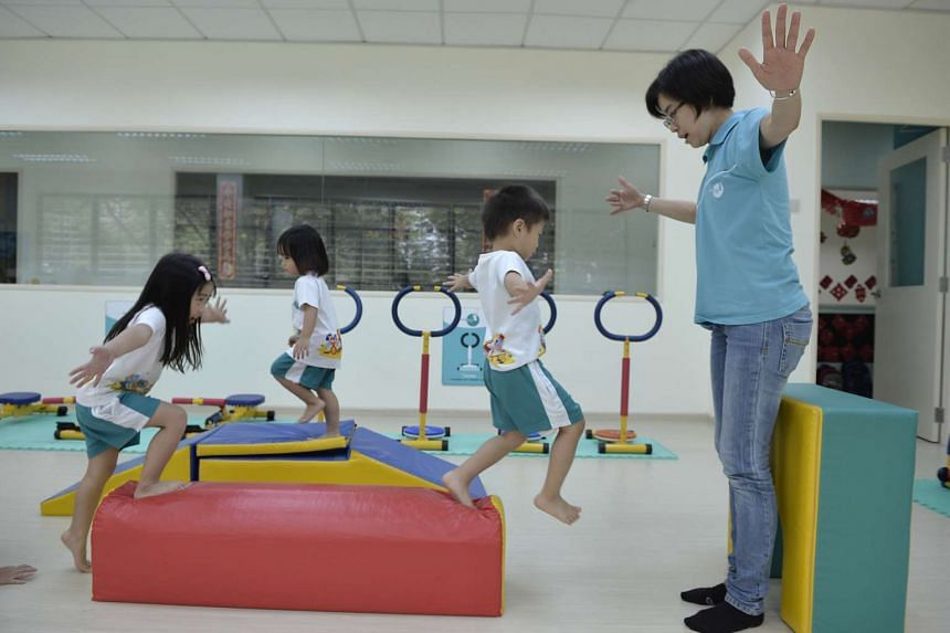 Preschool children using the fitness centre at ChildFirst Pre-school in Mountbatten, supervised by a teacher.