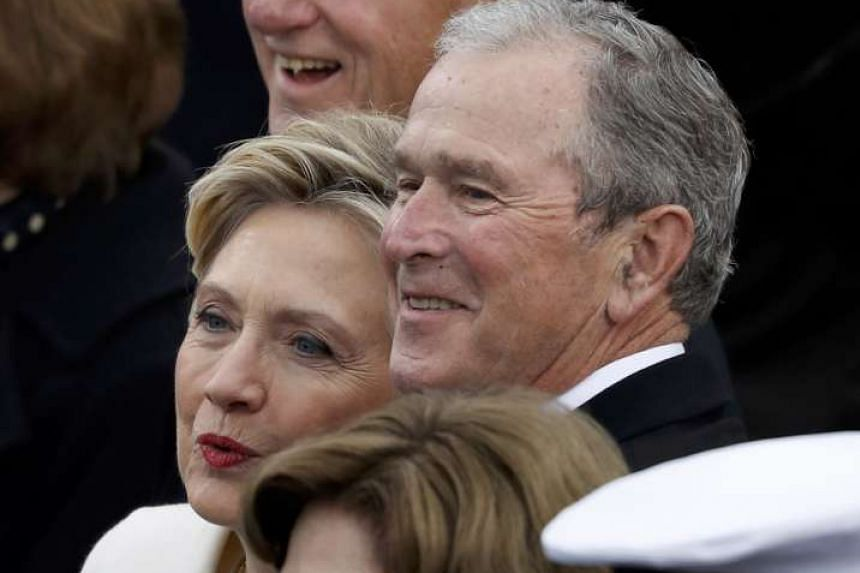 Hillary Clinton and US President George W. Bush wait for the inauguration ceremonies swearing in Donald Trump as the 45th president of the United States on the West front of the US Capitol in Washington, on Jan 20, 2017.
