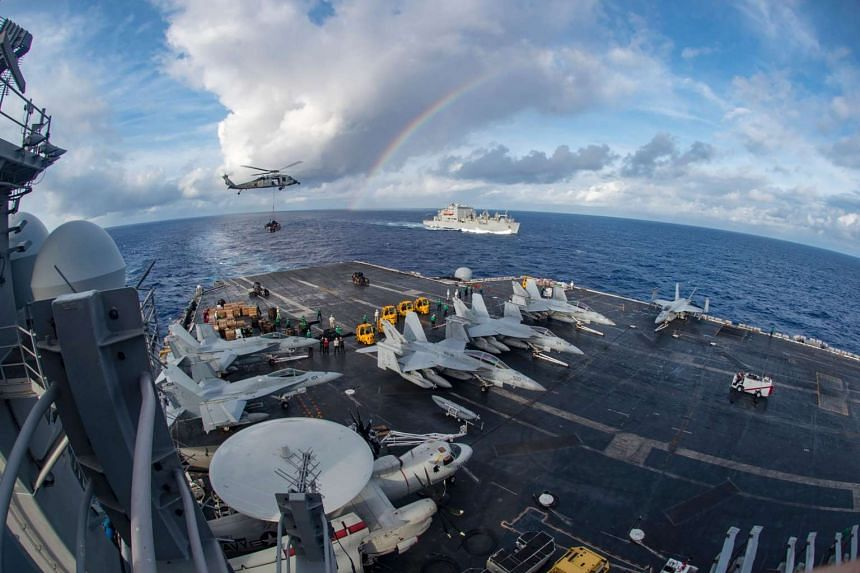 The US aircraft carrier USS Carl Vinson participating in a replenishment-at-sea with the cargo and ammunition ship USNS Charles Drew (background) on Feb 3, 2017.
