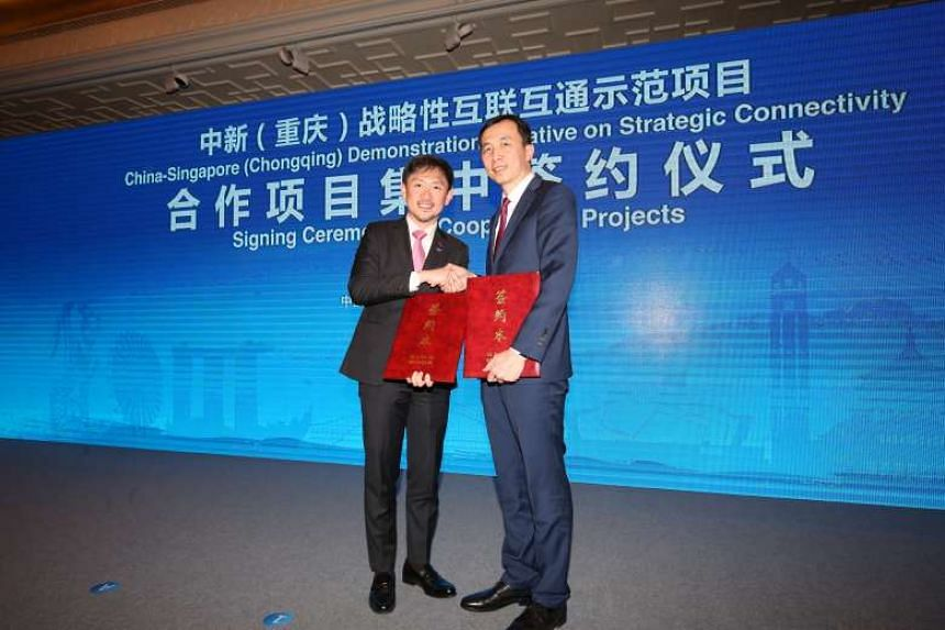 The joint venture agreement was signed by SPH deputy chief executive Anthony Tan (left) and ZBJ Network, Inc. President Wang Nan in Beijing.