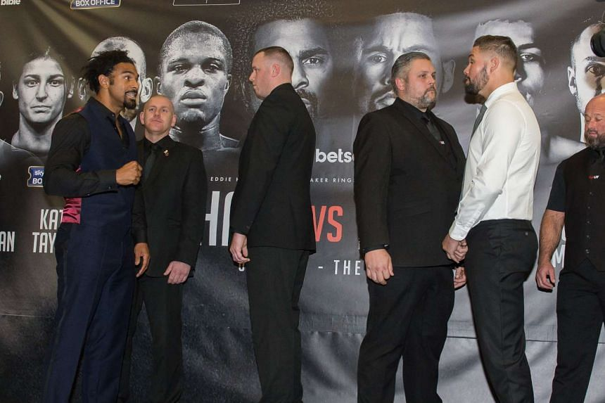 David Haye (left) and Tony Bellew (in white) facing each other during their press conference ahead of their fight, in Liverpool on Feb 27, 2017.