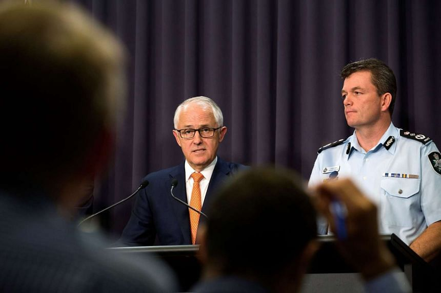 Australian PM Malcolm Turnbull (left), flanked by Federal Police Commissioner Andrew Colvin, speaking to reporters about the arrest of an Australian who was in contact with ISIS, on Feb 28, 2017.